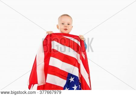 Little Kid Boy With American Flag, Happy Childhood. Soft Focus
