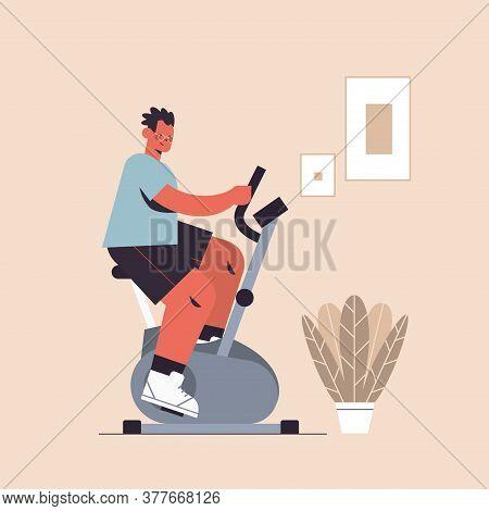 Sportsman Riding Stationary Bike Man Having Workout Cardio Fitness Training Healthy Lifestyle Sport