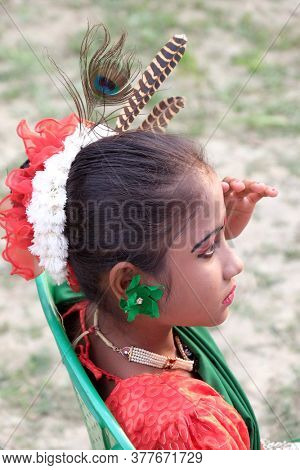 KUMROKHALI, INDIA - FEBRUARY 23, 2020: Portrait of Indian girl dancer in Kumrokhali village, West Bengal, India