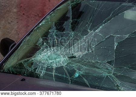Selective Focus Image On The Broken Windshield Of The Car. Car Accident. Broken Windshield Of A Car