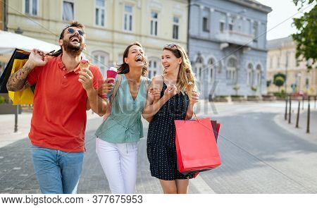 Young Friends Enjoying Shopping And Travel In The City. Happy Friends Shopping.