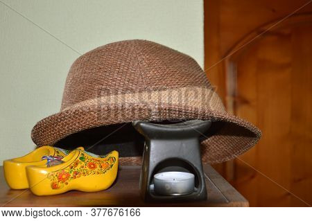 Travel Arrangement With Hat, Souvenirs And The Scented Candles