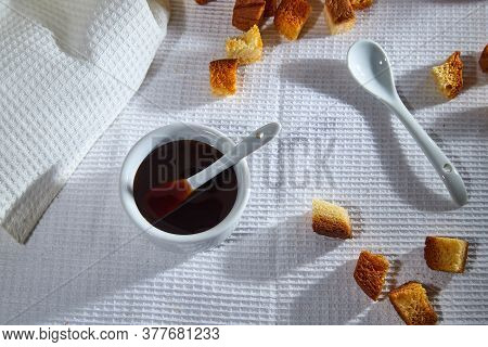 Liquid Honey In A White Plate And Square Toasted Pieces Of Homemade Delicious Rusk, Hardtack, Dryasd