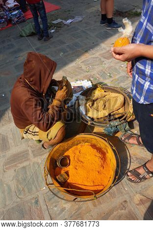 Kathmandu, Nepal - June 17, 2019: Selling colorful powder spices on street market, Local daily life