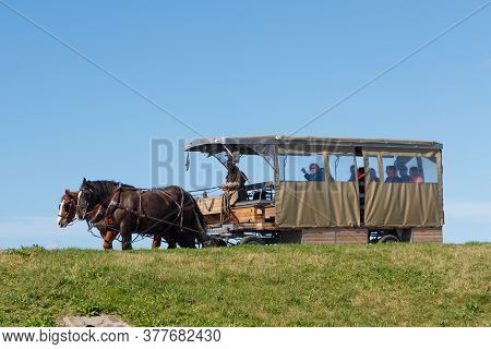 Mont Saint-michel - France, October 03 : Horse Drawn Bus Carrying Tourists In Mont Saint-michel, Oct