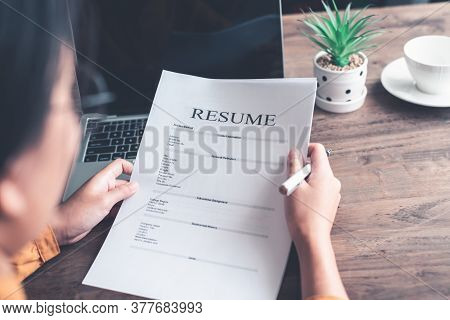 People Are Reviewing Job Applications Before Filling Out Their Resume On The Job Application Form In