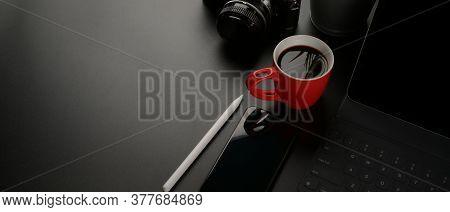 Dark Workspace With Digital Tablet, Smartphone, Coffee Mug, Camera And Copy Space