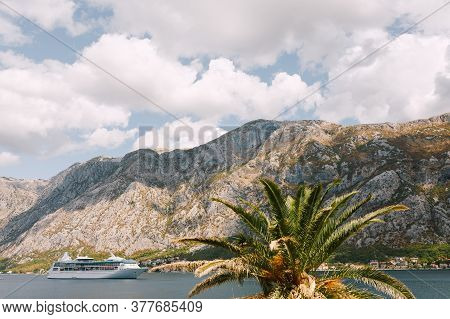 White Cruise Liner Against The Backdrop Of Rocky Mountains. Moored Ship Near The Cities Of Dobrota A