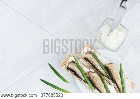 Cooking Of Healthy North Traditional Sandwiches Of Dry Crisps Wheat Bread With Sprats Fish, Cream Ch