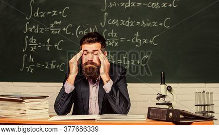 Painkiller Needed. School Teacher Have Pain In Head. Bearded Man Suffer From Pain At Lesson. Complai