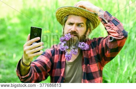 Cowboy Hipster In Field With Smartphone. Social Networks. Video Call. Internet Available In Most Rem
