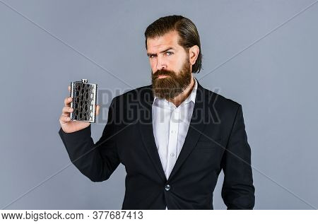Best Taste. Man Drinks Strong Alcohol From Iron Flask While Relaxing. Hip Flask For Whiskey. Vintage