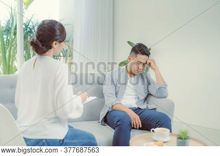 Famale Psychiatrist Listening To Her Patient Who Experienced Traumatic Events