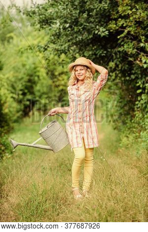 Watering Plants In Garden. Watering Tools. Girl Child Hold Watering Can. Spring Gardening Checklist.