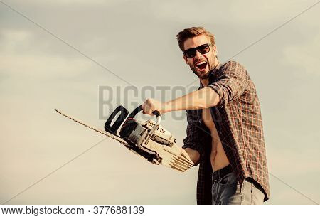 Lumberjack With Chainsaw In His Hands. Masculinity Concept. Sharp Blade. Dangerous Job. Feeling Manl