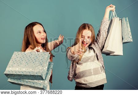 Shopping Day Happiness. Happy Children In Shop With Bags. Sisters Shopping Together. Buy Clothes. Fa