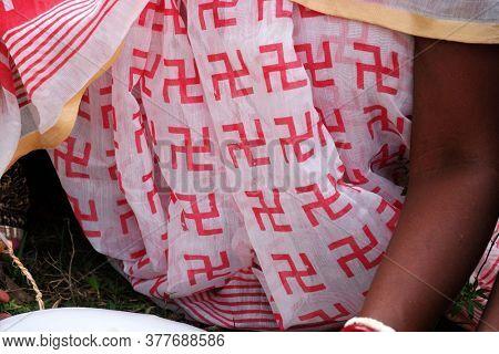 Colourful Indian sari with swastika motif, Kumrokhali, West Bengal, India