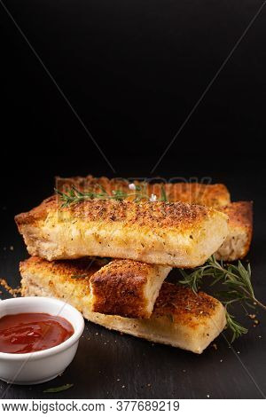 Food Appetizer Ideas For Party Concept Homemade Organic Garlic Bread Stick On Black Slate Board With