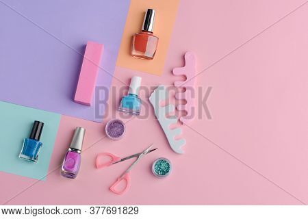 Varnishes, Scissors And Finger Separators On Manicurist Table