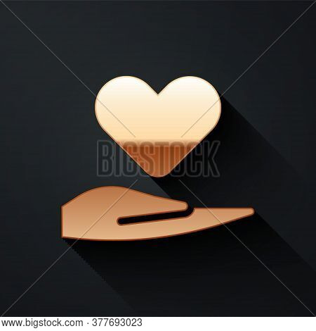 Gold Heart On Hand Icon Isolated On Black Background. Hand Giving Love Symbol. Valentines Day Symbol