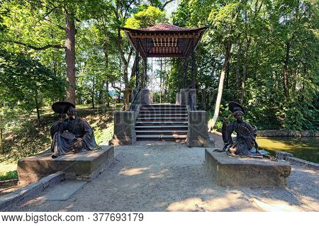 Bila Tserkva, Ukraine-july 18,2020:front View Of Scenic Chinese Bridge With Sculptures Of Chinese Wi