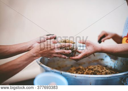 Poverty Concept : Feeding The Poor To Hands Of A Beggar