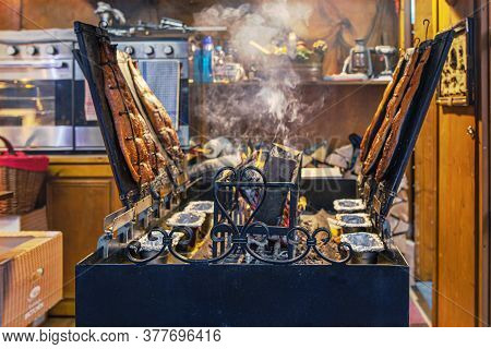 Christmas Market, Berlin, Germany - December 9, 2019 : Grill Smoked Fish On A Large Smoking Shed. Fo