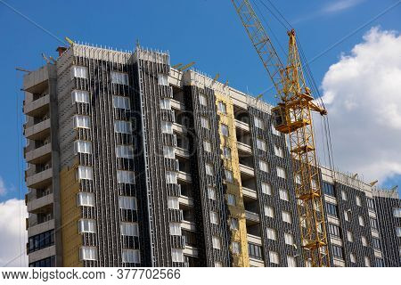 The Tower Crane That Built The House. Mortgage And Construction Concept.