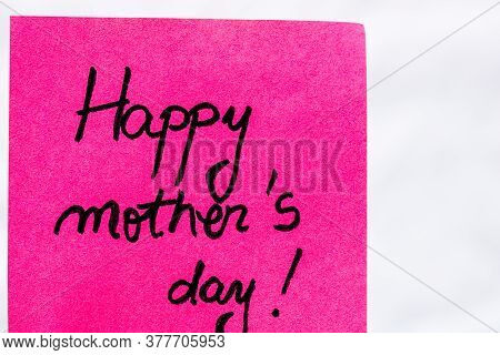 Happy Mother`s Day Handwriting Text Close Up Isolated On Pink Paper With Copy Space. Writing Text On