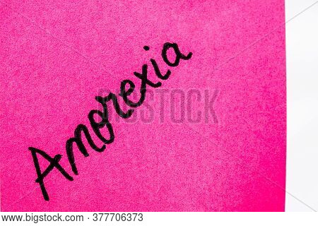 Anorexia Handwriting Text Close Up Isolated On Pink Paper With Copy Space. Writing Text On Memo Post
