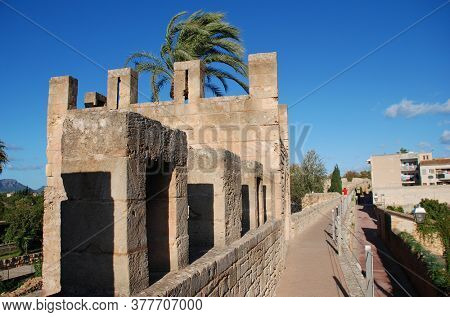 MAJORCA, SPAIN - NOVEMBER 12, 2019: The walkway on top of the medieval fortified wall at Alcudia Old Town on the Spanish island of Majorca. Alcudia is the main tourist resort in the North of Majorca.