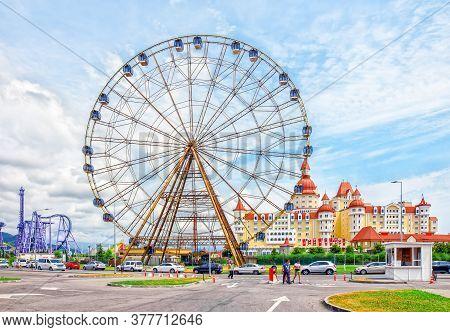 Sochi, Russia - June 21, 2019: Ferris Wheel And Children City In Amusement Park Sochi Park.
