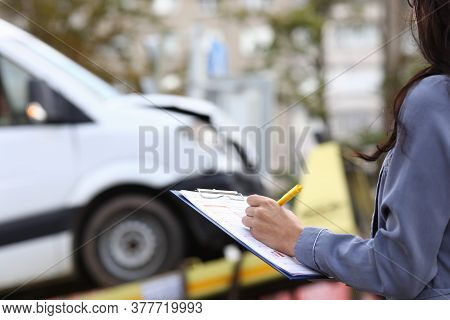 Insurance Agent Fills Out Paperwork After Accident. Third Party Liability Insurance For Vehicle Owne
