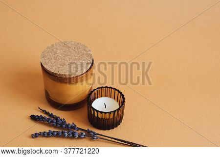 Two Aroma Candles With Ginger Scent And Dried Lavender Flower On Orange Background. Aromatherapy Con