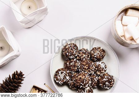 Swedish Chocolate Balls And Cup Of Cocoa With Marshmallow On Grey Concrete Table. Cozy Winter Breakf