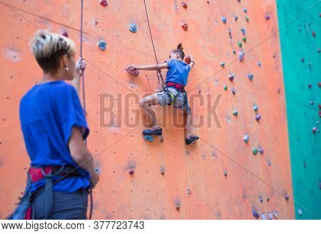 A Coach Teaches A Child, A Woman Is Belaying Her Son, A Boy And His Mother Train Together, Children'