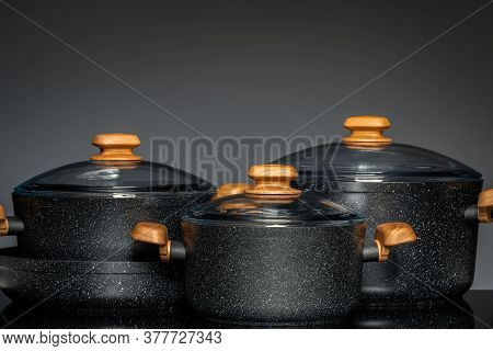 New Cookware On Black Background, Front View