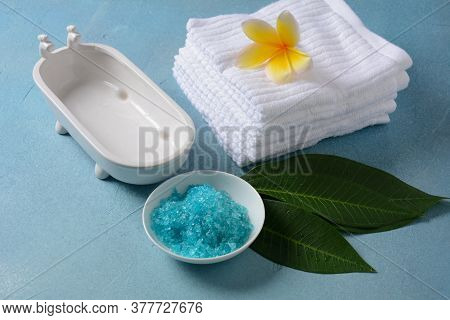 Spa And Body Care Products. Aromatic Blue Bath Dead Sea Salt On The Blue  Background. Natural Ingred