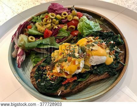 Eggs Florentine- Toasted Bread, Poached Eggs, Spinach And Delicious Buttery Hollandaise Sauce With S
