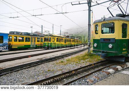 Kleine Scheidegg, Bernese Oberland, Switzerland - July 31 2019 : Multiple Trains From The Wengernalp