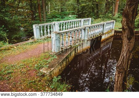 A Small Bridge With Balusters Over A Stream With A Reflection In The Forest. Nineteenth Century Arch