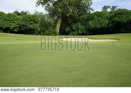 Beautiful Golf Course In A Sunny Day. Background Evening Golf Course Has Sunlight Shining Down. Golf