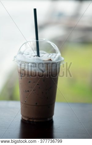 Iced Mocha Coffee With Milk Cream On Top In Plastic Glass