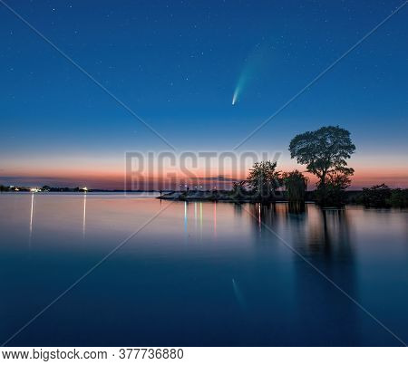 Comet C 2020 F3 Neowise In Night Sky Above Dnieper River, Ukraine. Reflection In The Water