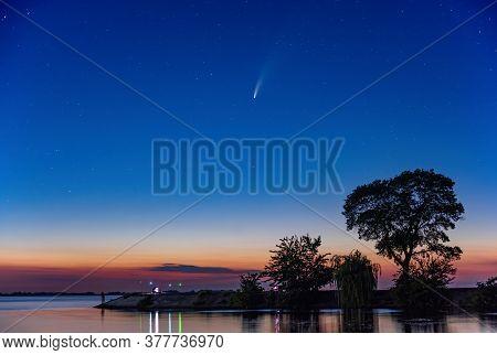 Comet C 2020 F3 Neowise In Night Sky Over Dnieper River, Ukraine.