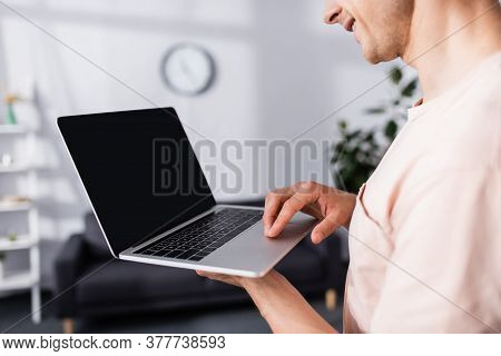 Cropped View Of Smiling Freelancer Holding And Using Laptop At Home, Earning Online Concept