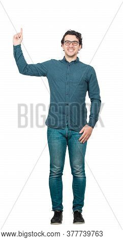Full Length Portrait Of Contented Businessman, Pointing Forefinger Up Isolated On White Background W