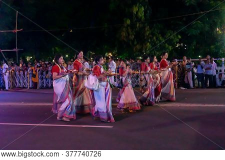 Kolkata, West Bengal, India - 3rd October 2017 : Bengali Hindu Ladies Dressed In Red And White Saris