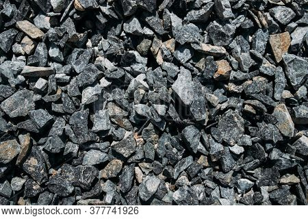 Rough Stones, Crushed Stone, Granite Gravel Close-up. The Rough Texture Of The Stone. Building Mater