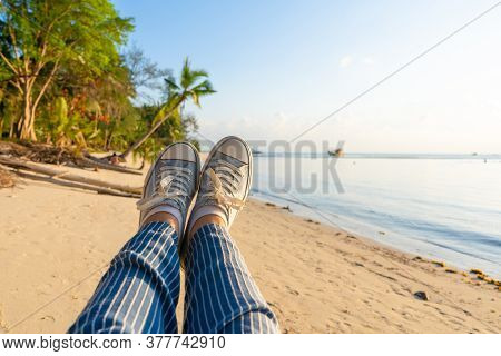First-person View, A Girl Swinging On A Swing On A Sandy Beach Of A Tropical Island At Sunset. Enjoy